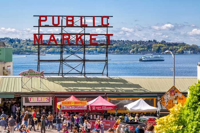 SEATTLE-APR 12, 2014: Historic Pike Place Public Market is one of the top attractions in Seattle, where locals and tourists shop for locally sourced, artisanal and specialty foods, flowers and crafts.