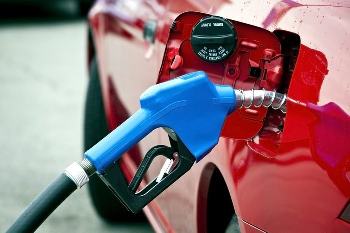 Blue Gasoline Nozzle Fueling Red Car/ Getting Gas/ Horizontal Shot