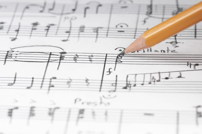 Music notes and pencil, shallow DOF