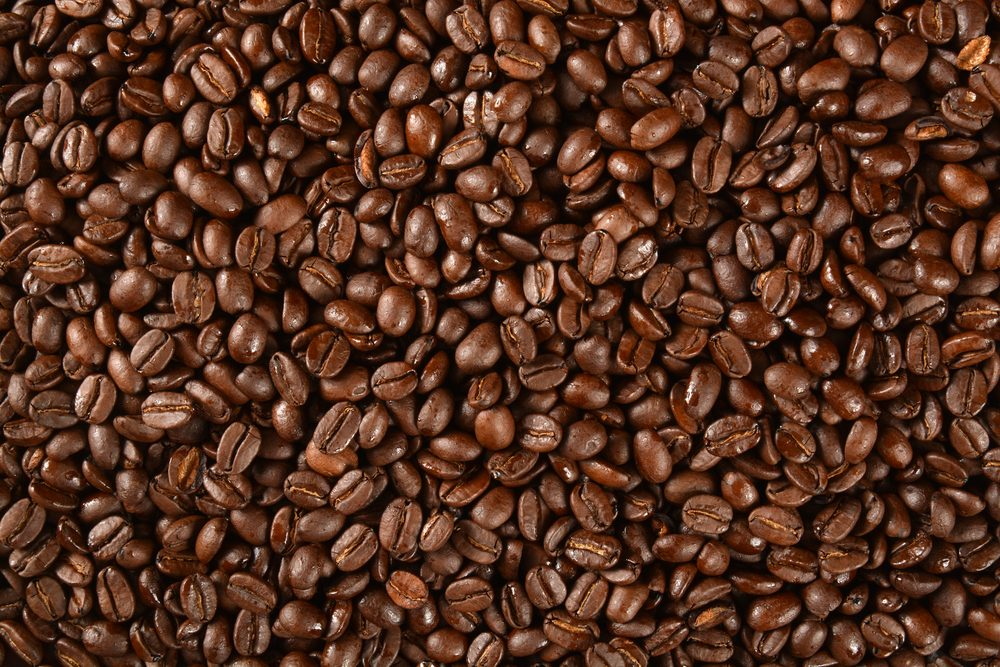 Dark roasted coffee beans from an overhead angle