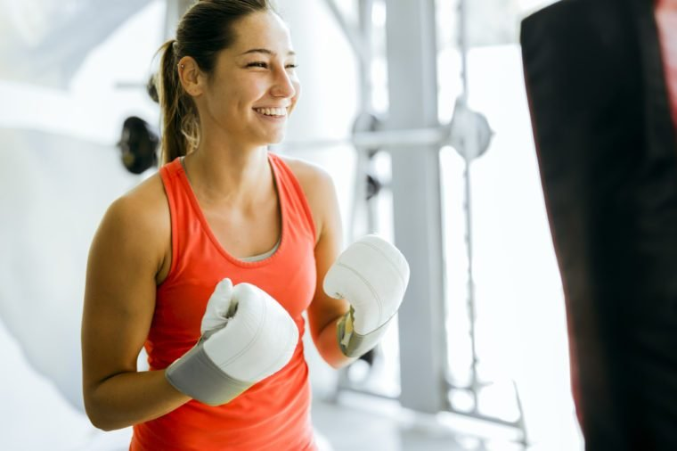 Young woman boxing and training in a gym