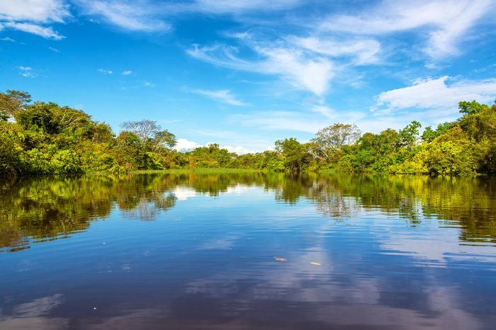 Sky being reflected in the Javari River in the Amazon rain forest