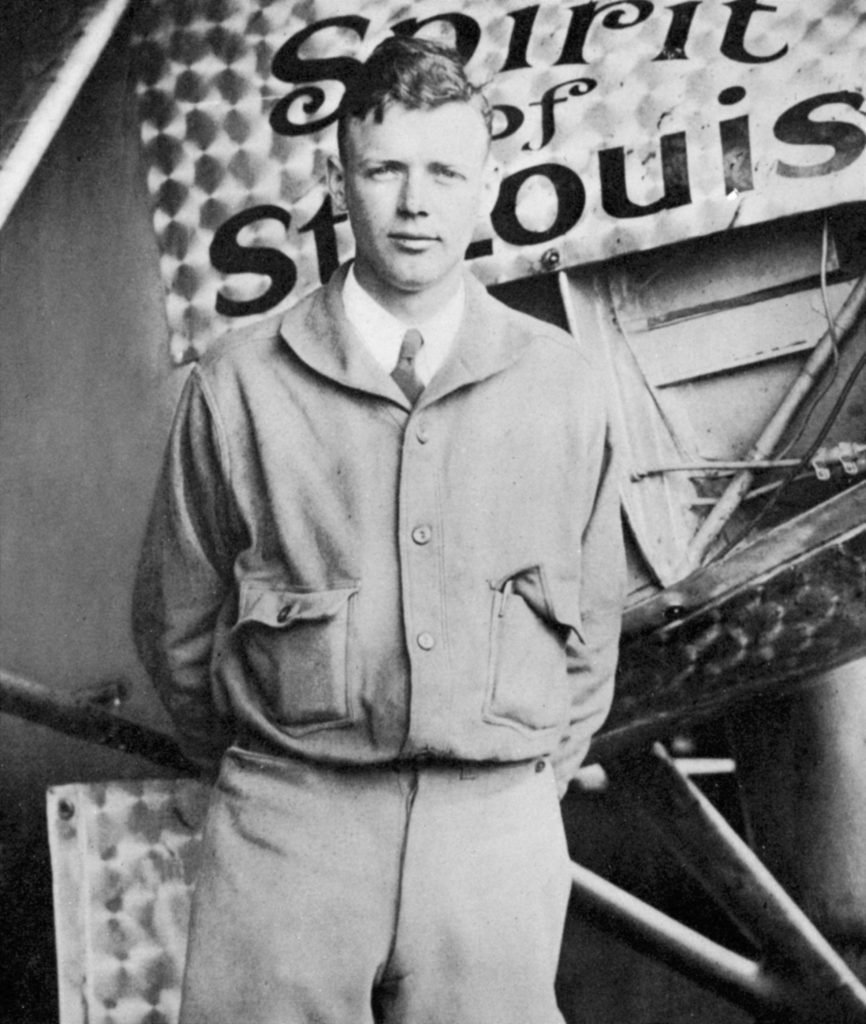 VARIOUS Charles Lindbergh (1902 - 1974) in his flying kit standing by 'Spirit of St Louis', the plane in which he made the first non - stop Atlantic air crossing: 20 - 21 May 1927. Landed at Le Bourget Airdrome, Paris, after a flight of 33.5 hours