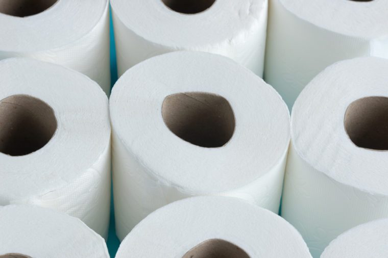 Constipation concept - Toilet paper and water closet concept - Close up rolls of toilet paper