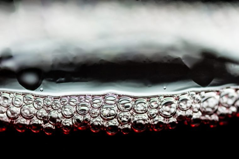 Bubbles in a glass of red wine close