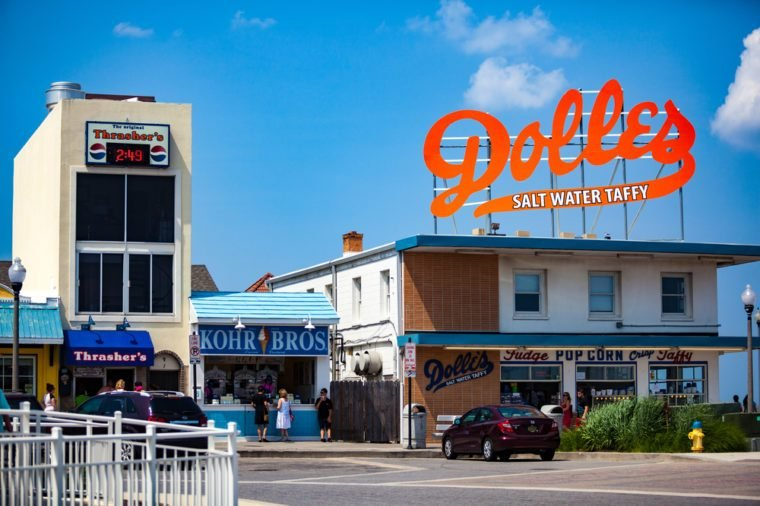 Rehoboth Beach, DE - June 25, 2013: The big orange Dolles Salt Water Taffy sign on top of the candy shop has become a Delaware landmark.