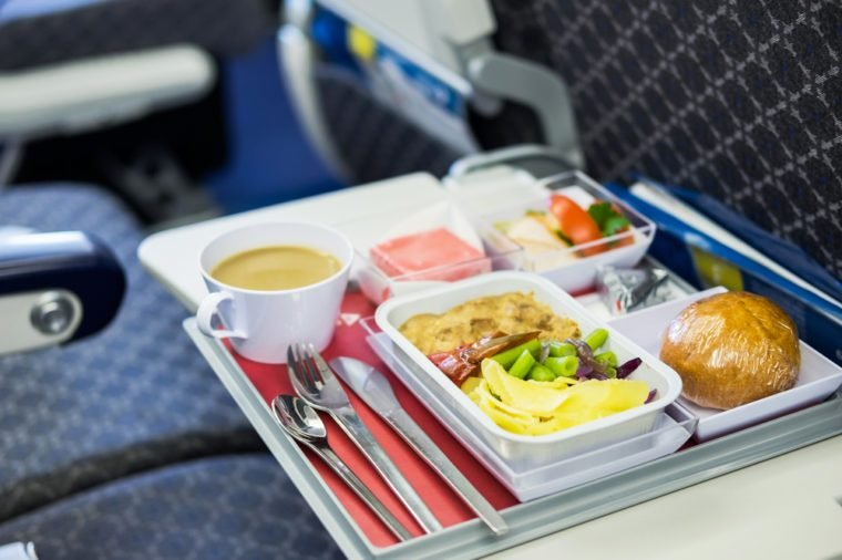 Food served on board of economy class airplane on the table