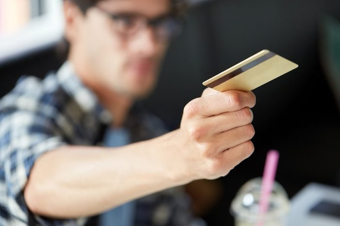 leisure, people, payment and finance concept - man paying with credit card at cafe