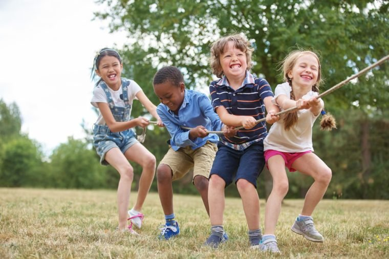 nterracial group of kids playing at the park