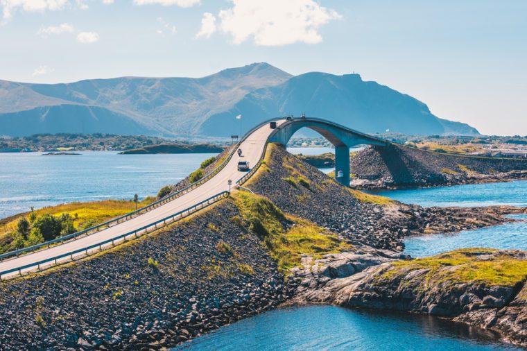 World famous Atlantic road bridge (Atlanterhavsvegen) with an amazing view over the norwegian mountains. Atlantic road runs through an archipelago in Eide and Averøy in Møre og Romsdal, Norway.