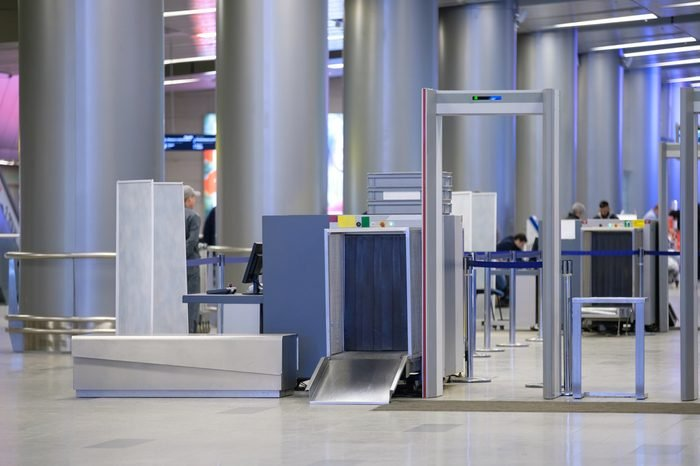 Security gates with metal detectors and scanners at entrance of airport