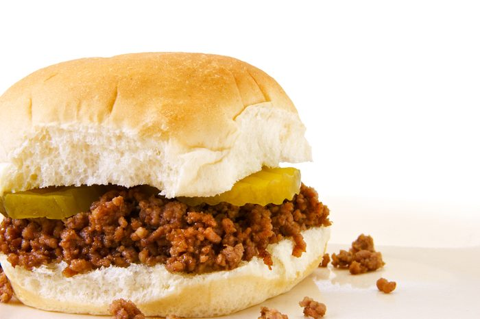 Loose meat (maidrite) sandwich on plate and white background