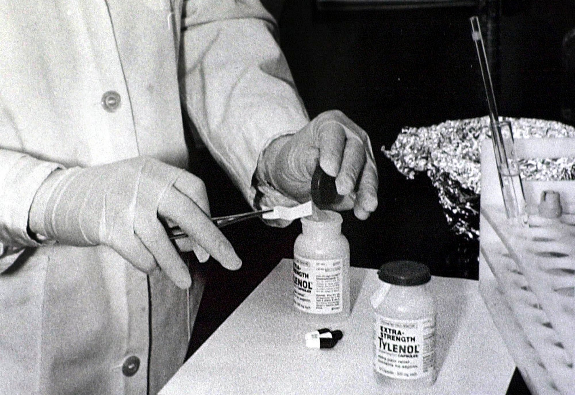 Bottles of Extra-Strength Tylenol are tested with a chemically treated paper that turns blue in the presence of cyanide at the Illinois Department of Health in Chicago. Arlington Heights, Ill., police say they'll take over the still-unsolved investigation into the deaths of seven people who took cyanide-laced Tylenol more than three decades ago. Local agencies will work together after the FBI decided to no longer lead the investigation into the 1982 Chicago area poisonings. The poisoned Tylenol was consumed over three days in Chicago and four suburbs, triggering a national scare and a huge recall Tylenol Poisonings, Chicago, USA