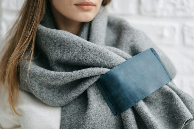 Winter warm scarf around the neck of the girl