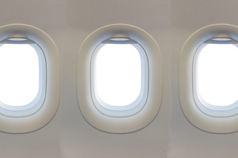 image of window on airplane with white color blank space.