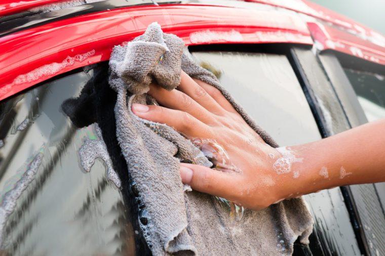 Young man car wash at home