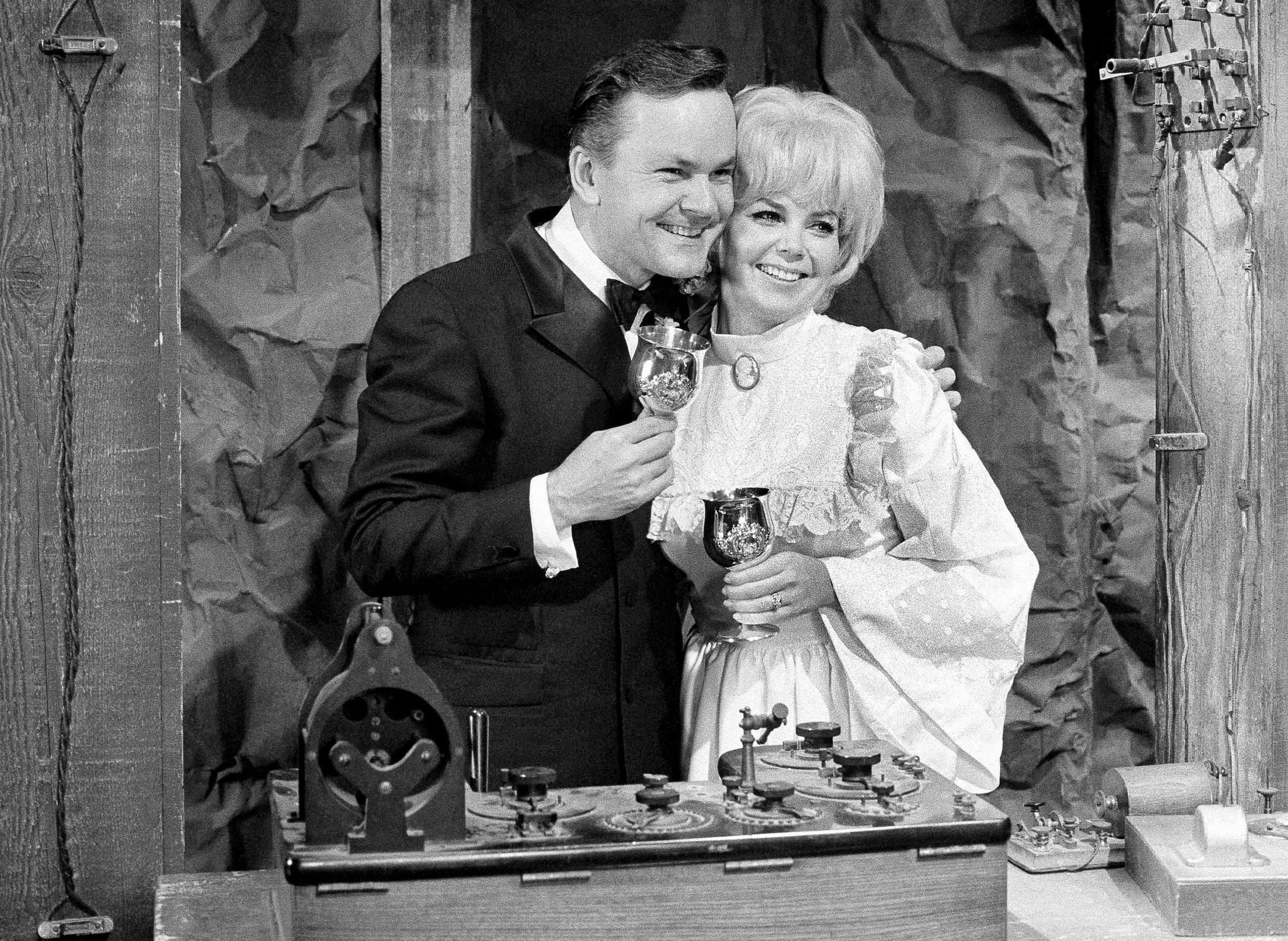 "Actor Bob Crane, star of the television series ""Hogan's Heroes"", poses with fellow cast member Sigrid Valdis after they were married on the studio set in Hollywood, . Valdis, who played Colonel Klink's secretary on ""Hogan's Heroes"", died Oct. 14, 2007. Scotty Crane told the Los Angeles Times that his mother died of lung cancer. She was 72 Obit Klinks Secretary, Hollywood, USA"