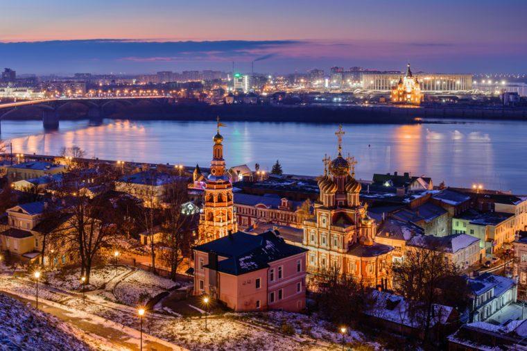 Beautiful panoramic view of the evening city near Kremlin with the Stroganov Church and Oka river. Nizhny Novgorod city, Russia.