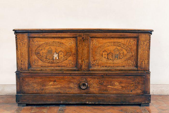 Antique italian wooden dresser, vintage old wood. Front view. Vintage style.