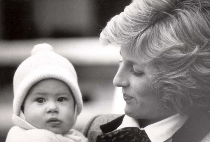 Princess Diana holding Prince Harry 1985