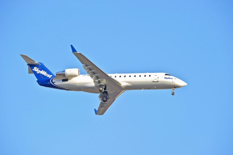 SkyWest Airlines Canadair CL-600 commercial jet on approach to runway at Los Angeles International Airport in Los Angeles, California, USA