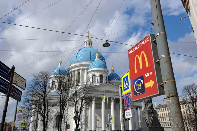 St.Petersburg, Russia - April 23, 2016: view of Trinity Cathedral and a pointer to the McDonald's in St. Petersburg, Russia