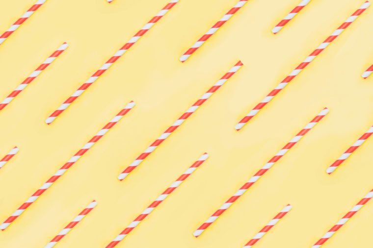 pattern of white and red drinking straw on yellow background