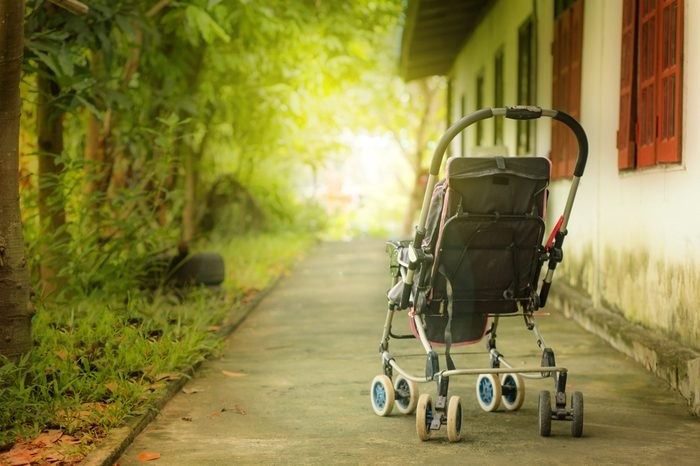 memory with baby stroller walks at sunset.