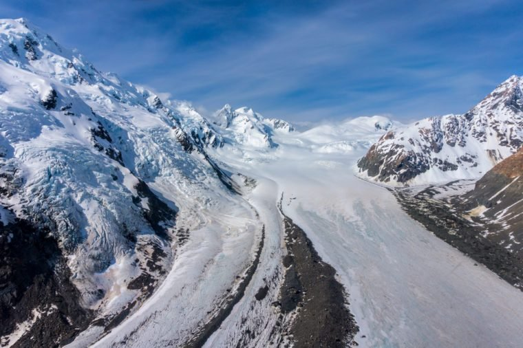 Aerial view of Tasman glacier and mountain ranges in Mount Cook National Park, New Zealand. Shot from helicopter.