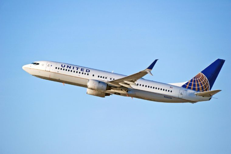 United Airlines Boeing 737 aircraft is airborne as it departs Los Angeles International Airport. Los Angeles, California USA