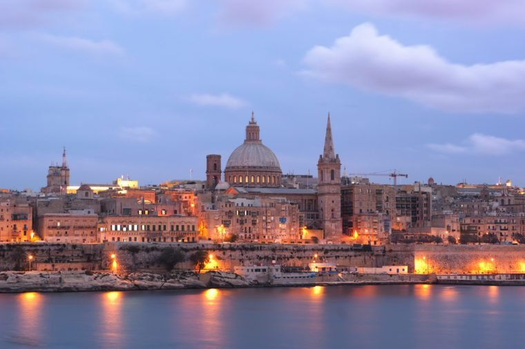 night view of Valletta with the St. Pauls Cathedral and Charmelite Church at the twilight