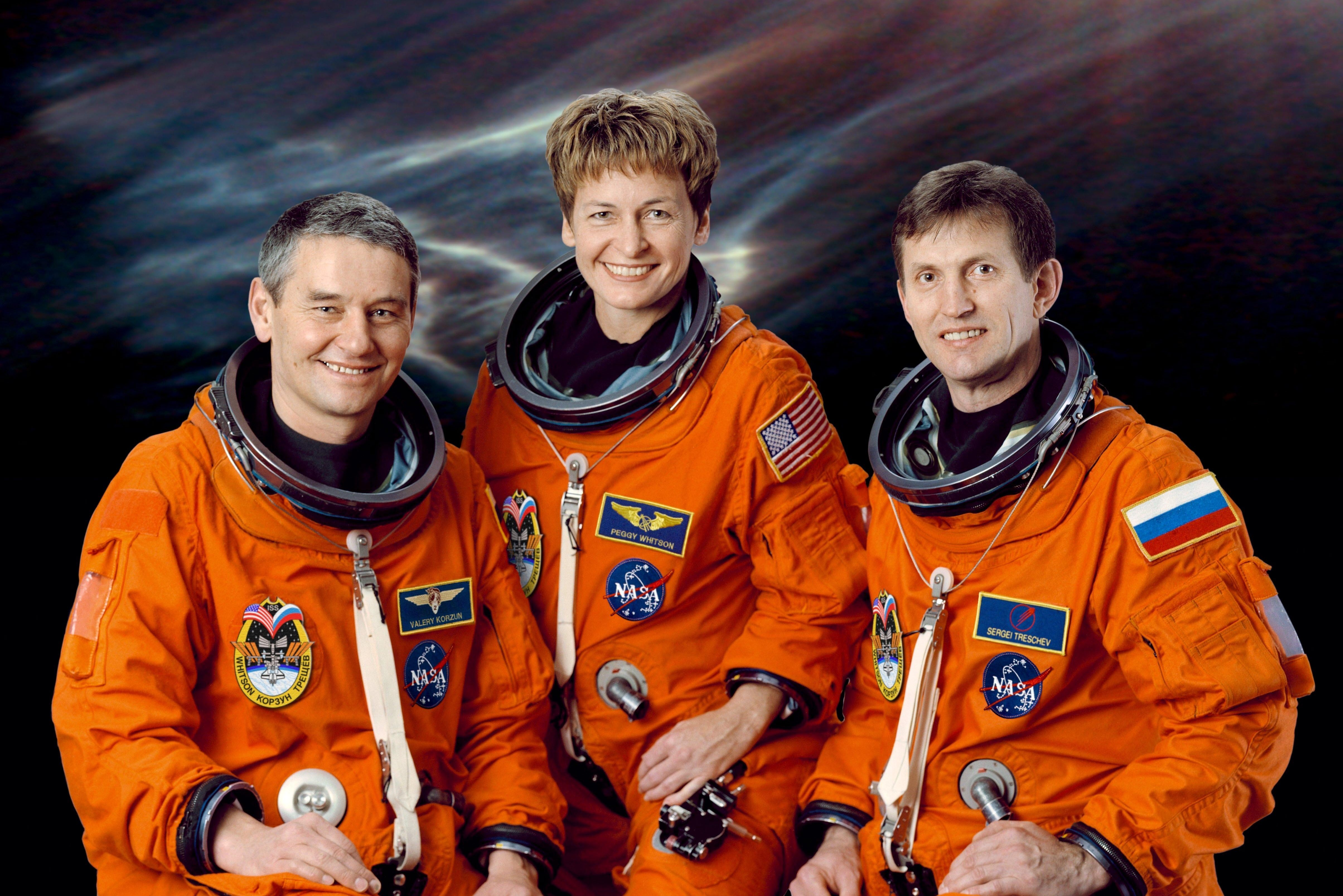 Mandatory Credit: Photo by Shutterstock (380733b) Cosmonaut Valeri G. Korzun (left), Expedition Five mission commander; astronaut Peggy A. Whitson and cosmonaut Sergei Y. Treschev, both flight engineers, attired in training versions of the shuttle launch and entry suits. VARIOUS ASTRONAUTS FROM ISS EXPEDITION 5, AMERICA - 28 NOV 2001