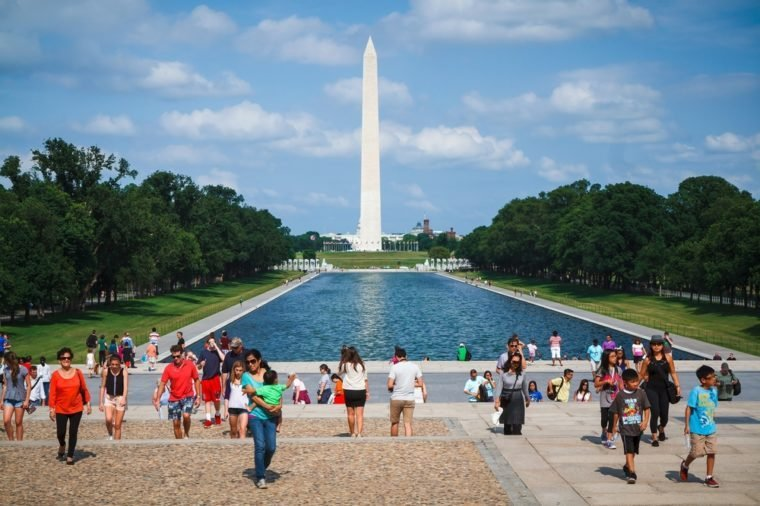 WASHINGTON, D.C. - JUNE 11, 2014: People enjoy sunny day in front of Lincoln Memorial with Washington Monument in the background.