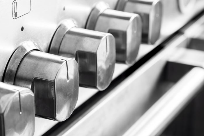 Close up image of stainless steel cooker controls