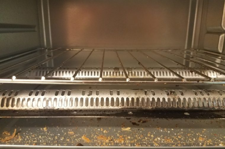 inside a toaster oven with bread crumbs
