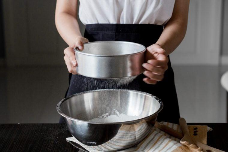 Sifting flour through a sieve