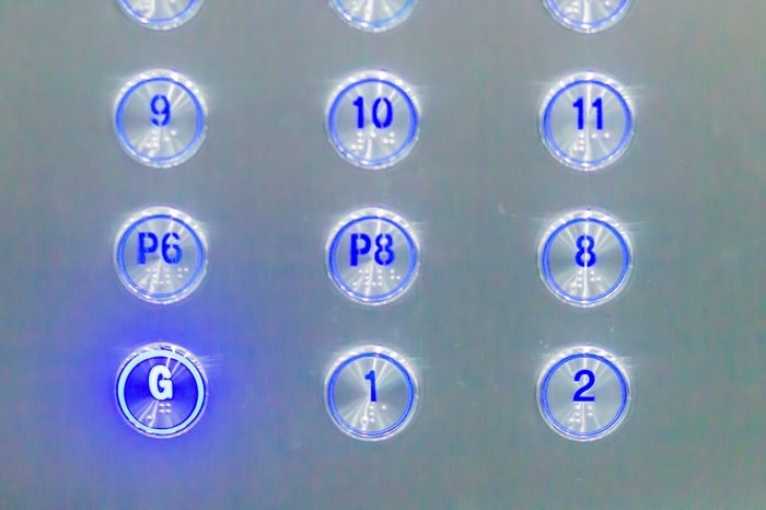 Blue elevator buttons pressed G lift down to ground floor