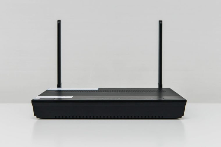 Black wireless router on the white table