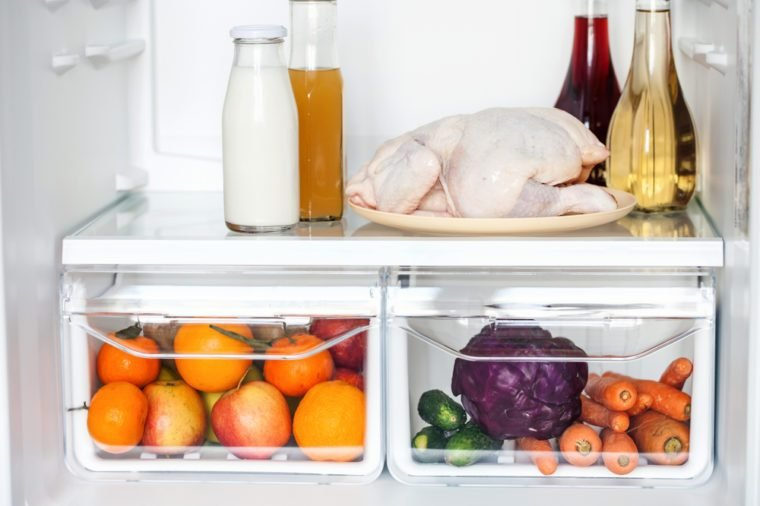 Vegetables and fruits in open refrigerator. Weight loss diet concept.
