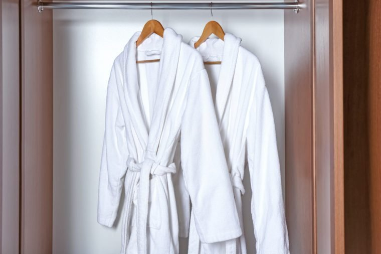 Spa bathrobes hanging in wardrobe