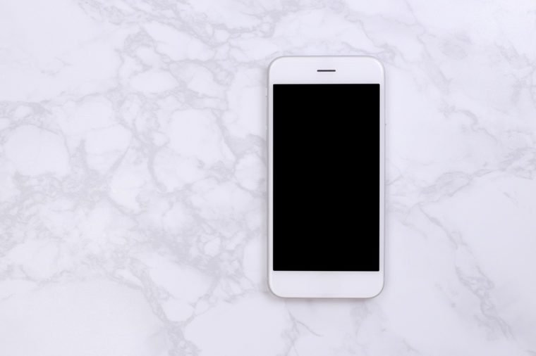 White mockup smartphon on marble background