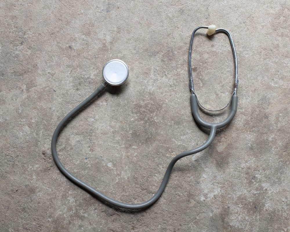 Stethoscope on gray background