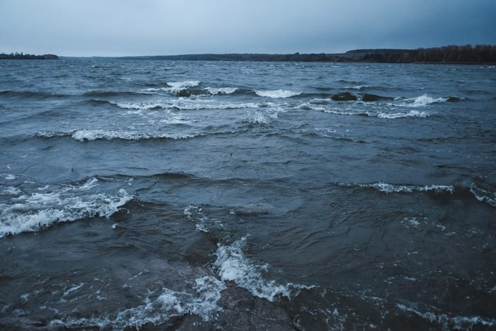 Waves on the lake during a storm, cloudy weather