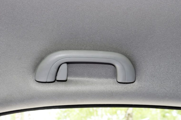 The car handles, the interior of the vehicle.Handle for the passenger. The handle is on top of the ceiling.