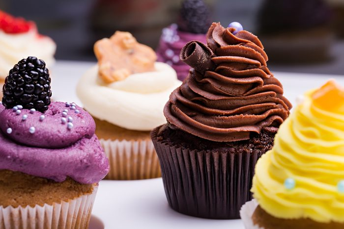colorful cupcakes with different Tastes. Small beautifull cakes on white table top. Close up