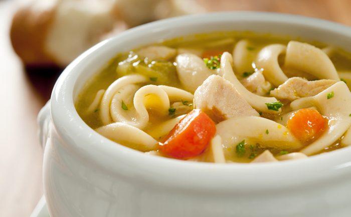 Closeup of chicken noodle soup.