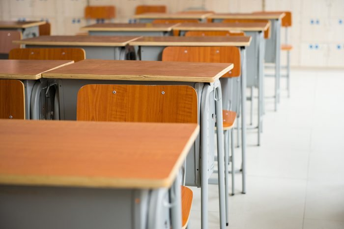Empty classroom with chairs and desks.
