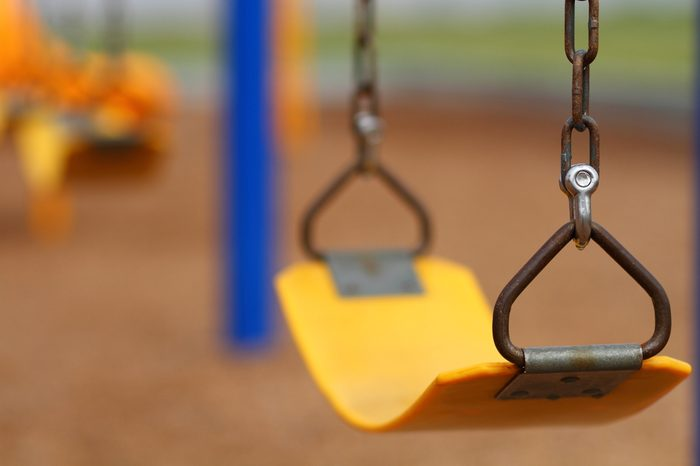 Playground swing set (selective focus)