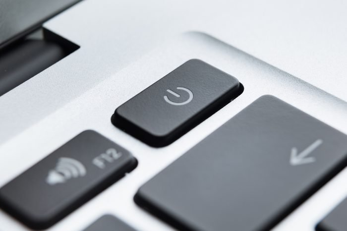 Close up of part of laptop keyboard. Focus on power button