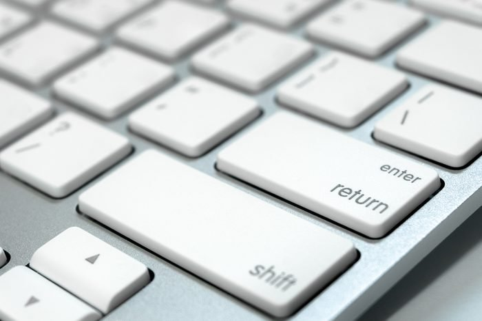 Close up keyboard of a computer on focus at enter button